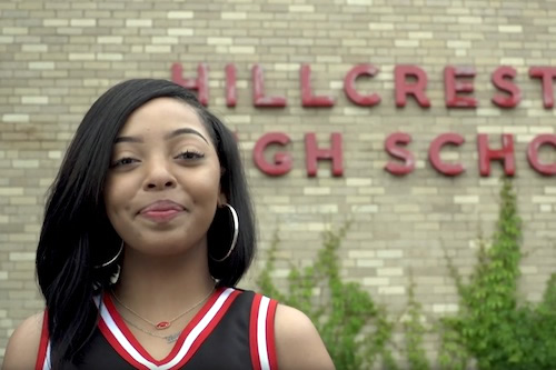The grad overcame Bell's Palsy and a dislocated arm to lead the Hillcrest cheer team