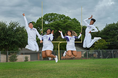 Cheerleaders jumping in the air