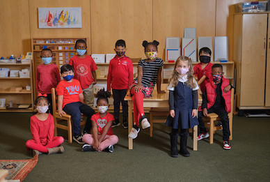 Group of elementary students wearing masks.