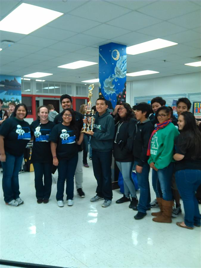 Cougars1 Robotics Team and their 1st place trophy at the Dallas Invitational Robotics Competition.