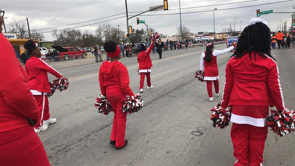Longhorn cheerleaders participate in the MLK Day parade